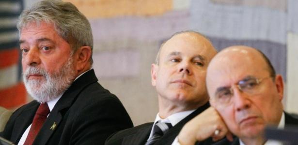 O presidente Luiz Inácio Lula da Silva, o ministro da Fazenda, Guido Mantega, e o presidente do Banco Central, Henrique Meirelles
