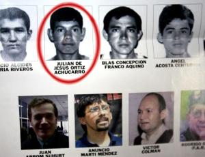 Suspeito de pertencer ao EPP é assinalado em cartaz com suspeitos procurados pela polícia paraguaia