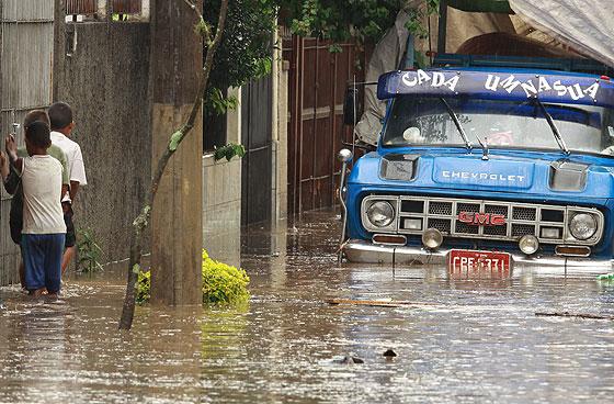Imagem da rua Conchilia, no bairro do Tremembé, zona norte da cidade, completamente alagada